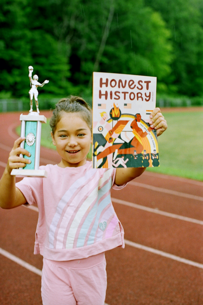 Athletic Girl with Olympic Issue of Honest History Mag