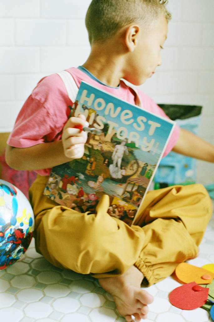 Kid Reading art issue of Honest History Mag