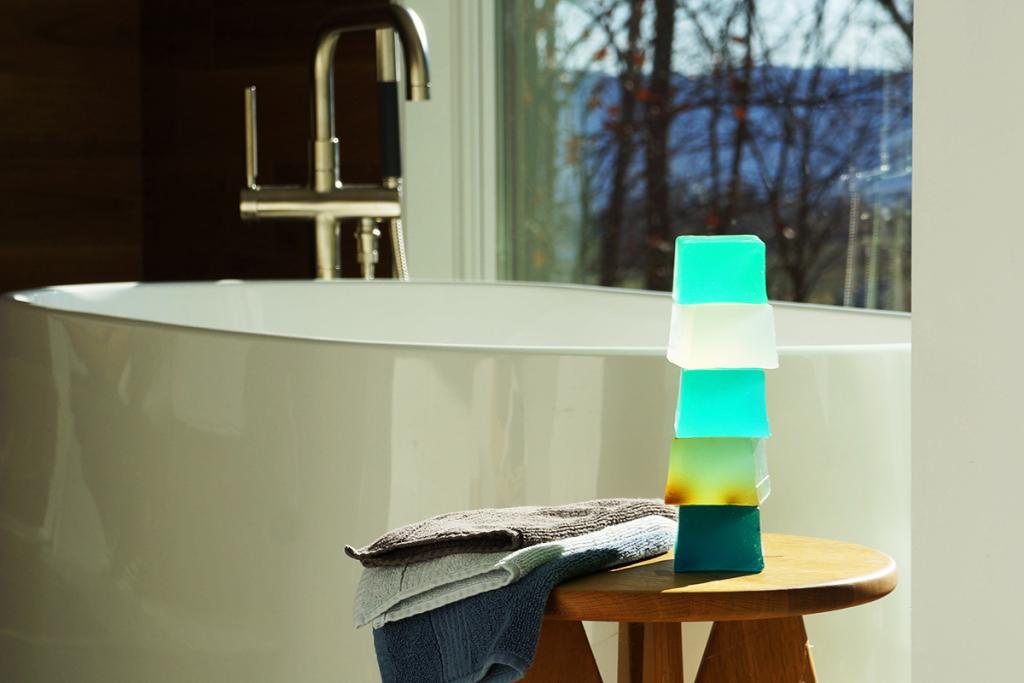 neon bars green soaps near bathtub