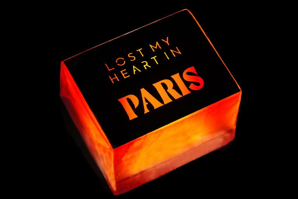 neon bars Paris soap on black background