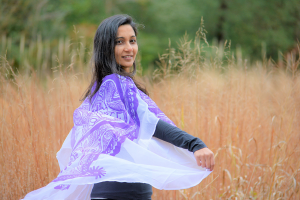 Loveleen twirling in field with Purple shawl
