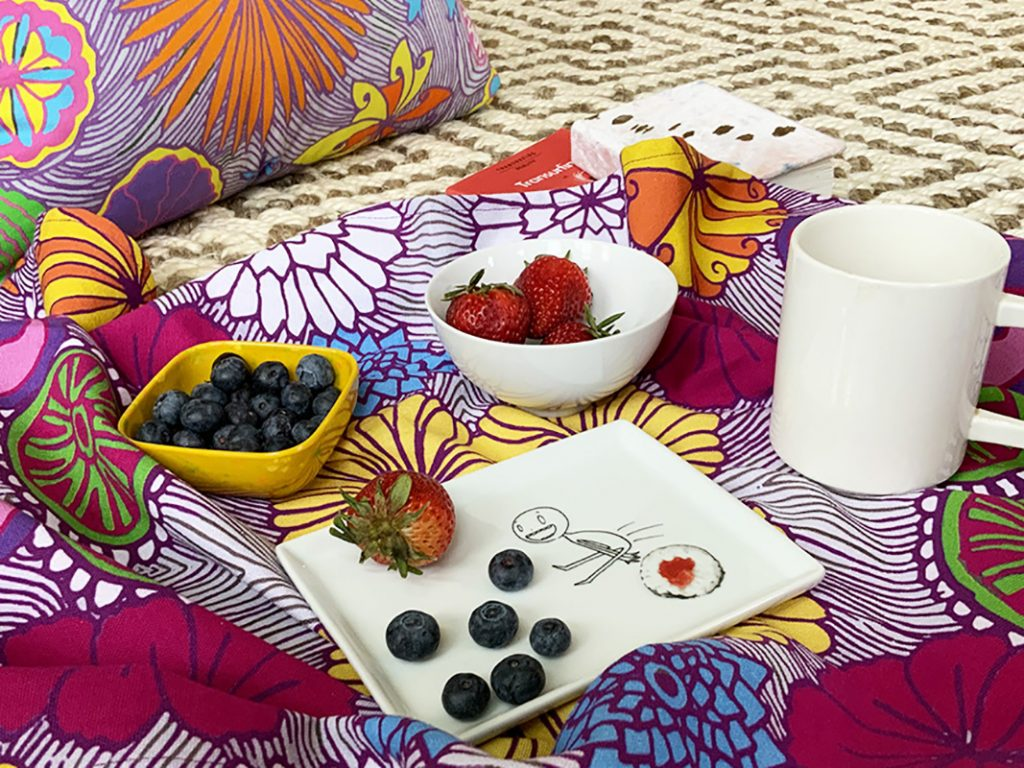 Designs by Loveleen floral mat with strawberries and blueberries on top of it