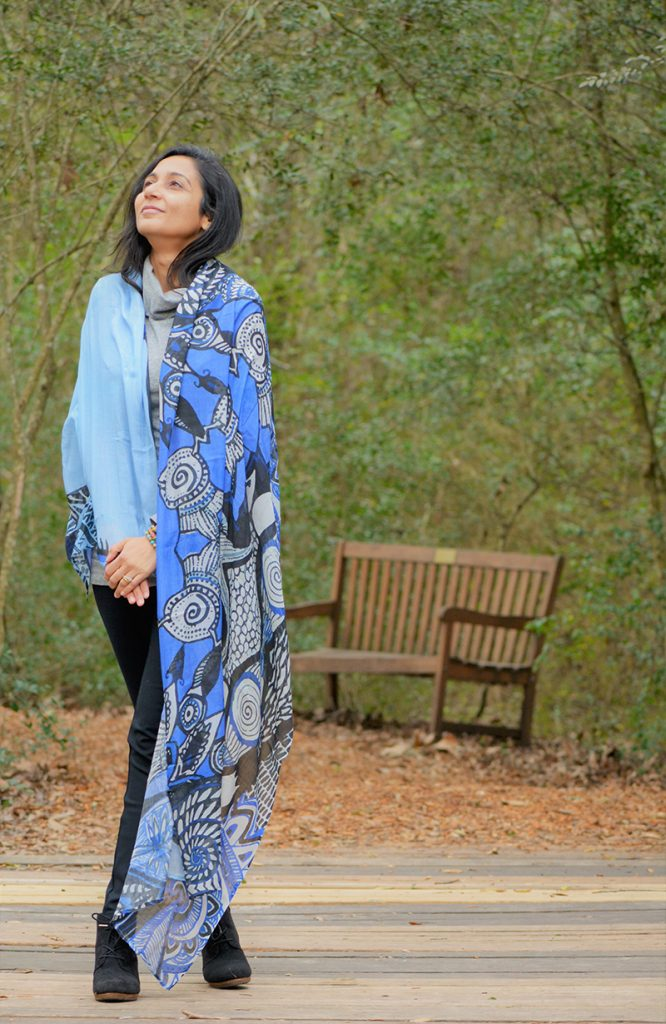 Loveleen, a woman, standing by park bench with blue patterned shall