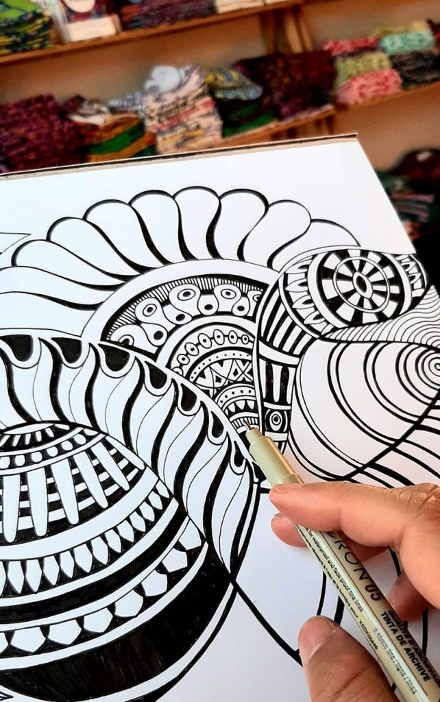 Design being drawn by artist, black and white