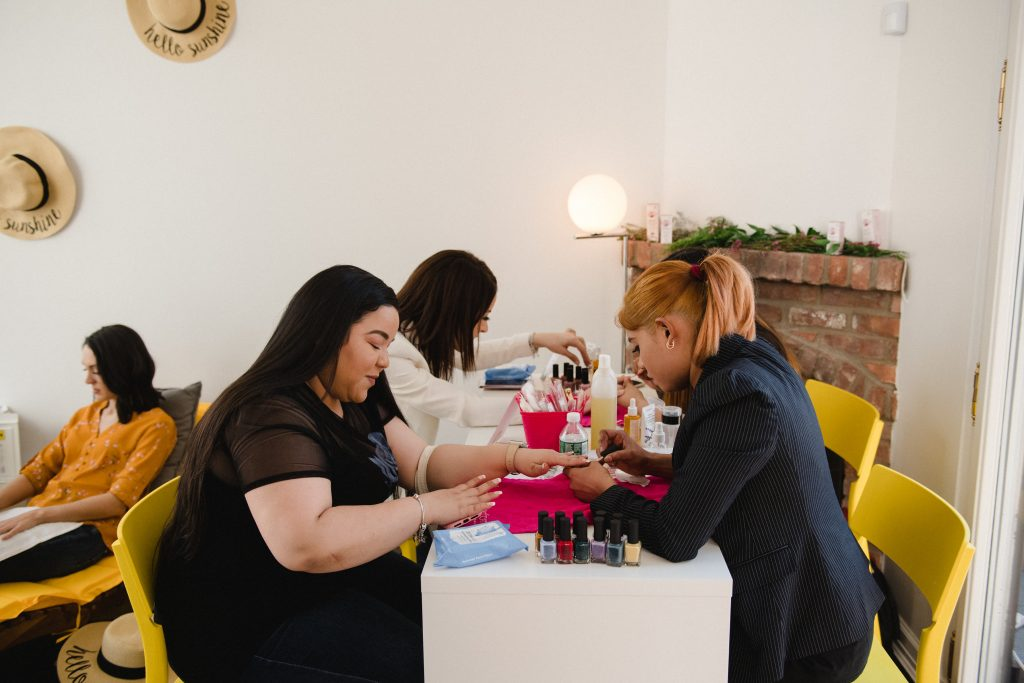 Maniorpedi in action - doing nails at workplace