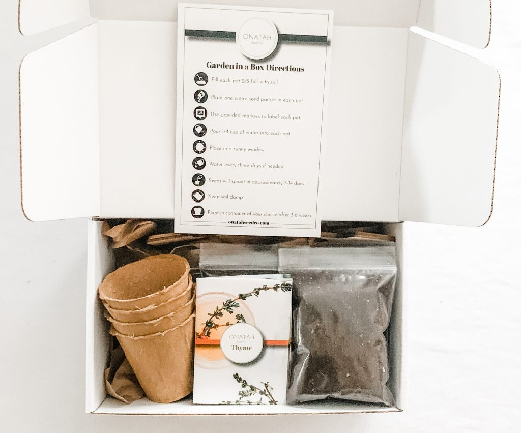 Onatah Seed Co. look inside the garden in a box with soil, seeds, small cups, and directions