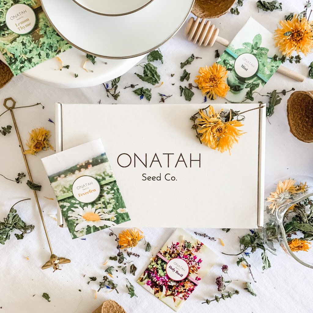 Onatah Seed Co. Box with seed packets and flowers