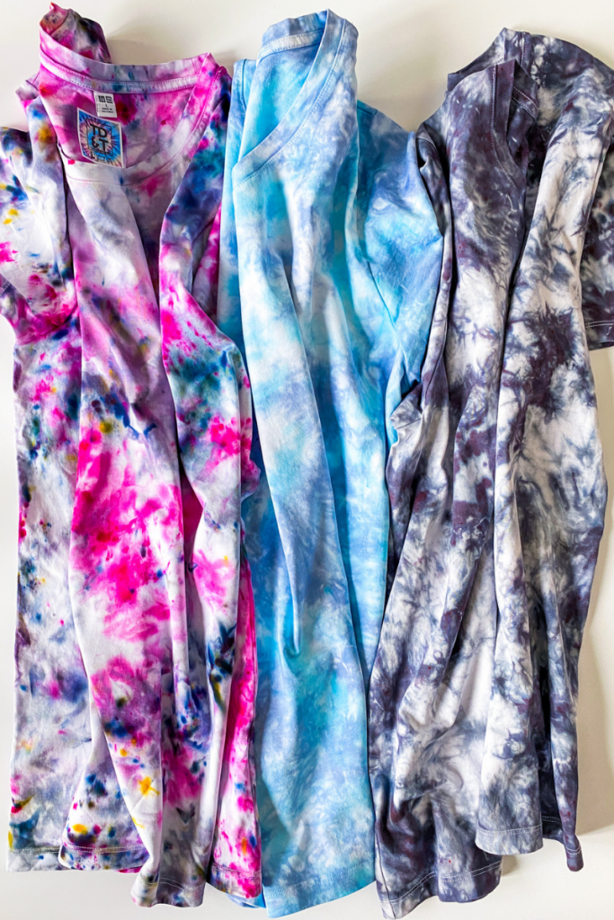 Three tie dye t-shirts in pastel colors - pink, blue, and purple