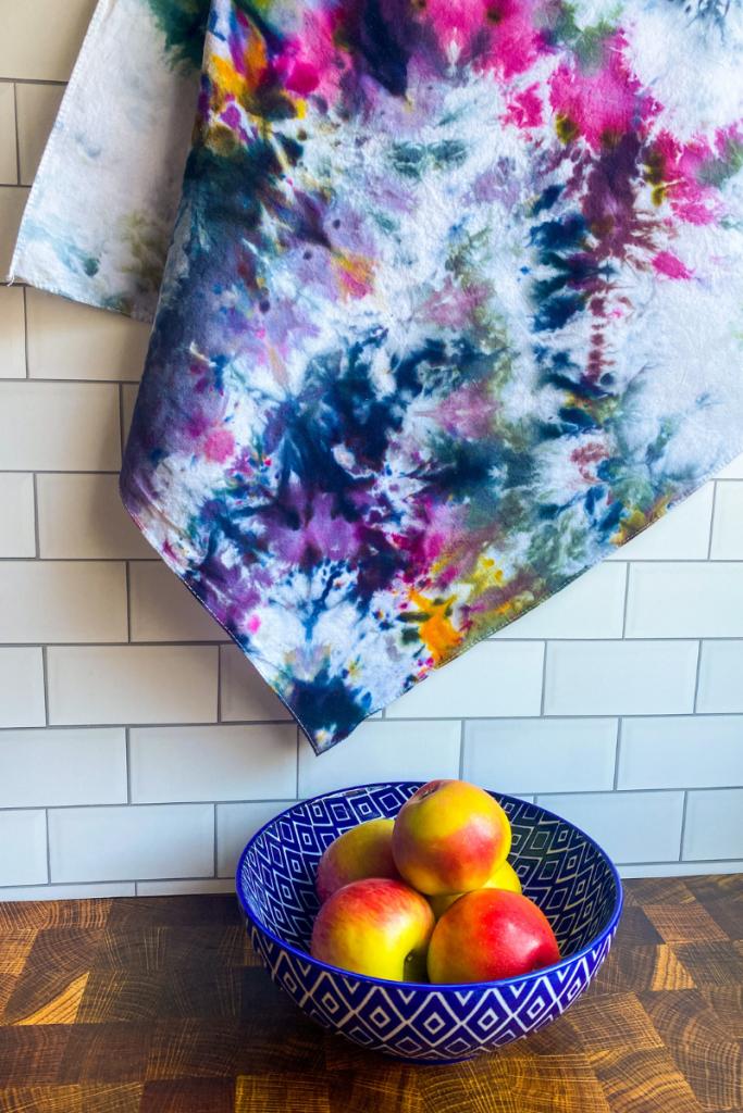 Tie Dye towel hanging over bowl of apples