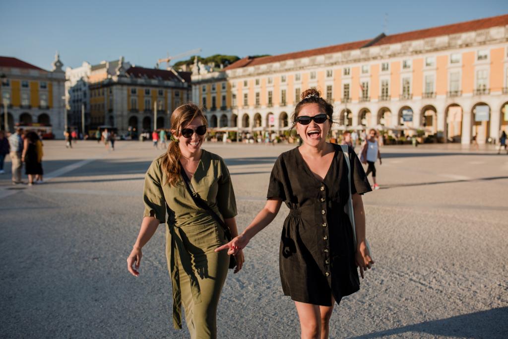 Two women walking in Lisbon Portugal